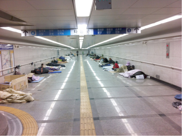 Seoul's subway at 7pm where 33 or more homeless call home. This situation in South Korea is in stark contrast to that in its northern socialistic neighbour where housing has been expropriated from the landlords and collectivised to provide free public housing. Surely with great wealth, with the likes of Samsung, LG, and Hyundai they can afford to house these South Korean citizens.