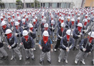 Above: South Korean Ssangyong workers armed with metal pipes during their 2009 industrial struggle with the car company. In South Korea workers have a strong history of resisting their exploiters and subsequently being brutalised by the capitalist state.