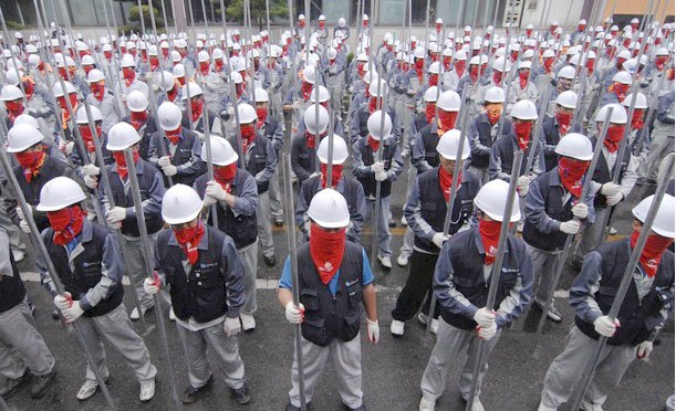 South Korean Ssangyong workers armed with metal pipes during their 2009 industrial struggle with the car company. In South Korea workers have a strong history of resisting their exploiters.