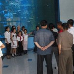 North Koreans take photos at the Pyongyang Aquarium.