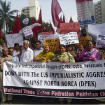 "Karachi, Pakistan, May 2013: Pakistani trade unionists and leftists hold a determined rally in defence of the DPRK. Speakers and slogans at the rally not only hailed North Korea's struggle against imperialist aggression but pointed to its socialist foundations. Unlike in imperialist countries like Australia, where anti-communist media propaganda has at the moment bred popular suspicion of North Korea, North Korea's defiance of imperialist threats has won it much sympathy from the masses of the many ex-colonial countries (like Pakistan) still suffering under neocolonial domination. Politically aware sections of the masses in ""Third World"" capitalist countries like Pakistan are also aware that despite the DPRK being ground down by sanctions and imperialist encirclement, workers in socialistic North Korea enjoy more humane working conditions and better access to health care, education and housing than they do in their own countries. A pro-working-class, DPRK solidarity movement needs to be built in Australia by cutting through the anti-DPRK propaganda and by pointing to the pro-working class character of the DPRK state."