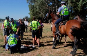 "March 2012: Police attack and arrest protesters at the Nyoongar Aboriginal Tent Embassy in WA. As refugees, guest workers and non-white migrant communities are attacked by the racist establishment spewing hysterical claims that these immigrants are ""flooding the country,"" this same ruling class establishment conducts vicious racist oppression of this country's first peoples. Unlike refugees and other migrants who come to this country merely to seek a better life, the British colonialists that established capitalist Australia came with the purpose of conquering the Aboriginal people and plundering their land. The Australian capitalist rulers' continued racist assaults on Aboriginal people are, just like their attacks on refugees, aimed at scapegoating vulnerable communities for the poor social services and other hardships caused by their system and additionally at justifying their ongoing conquest of Aboriginal people's land."