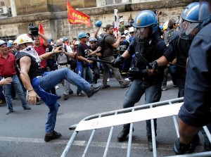 Rome, Italy, September 2012: Workers from aluminium maker Alcoa's Sardinia factory try to break police lines to storm the Industry Ministry in an attempt to defeat threatened job losses.