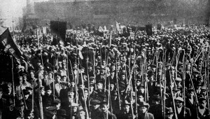 Russia, 1917: Armed, pro-communist masses march on the capitalist Provisional Government.