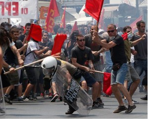 Greece, June 2011: Youth opposing grinding austerity take firm action against police. The desperate Greek masses are seething with discontent at the ruling order. However, the likes of the left social-democratic Syriza party are directing the masses' anger away from a revolutionary direction.
