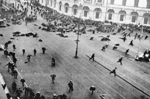 Petrograd (now St Petersburg), Russia, July 1917: Demonstrators lie flat on the street and run for cover after the capitalist Provisional Government unleashed troops to open fire on a huge demonstration of pro-communist workers and their allies. The capitalist military killed or injured hundreds of demonstrators. This incident occurred just three months before the 1917 Russian Revolution. The workers can only take power by physically smashing the violent efforts of the capitalists to cling on to their rule.