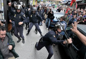 Spain, 29 September 2010: Police attack workers picketing in Santiago de Compostela, northern Spain, during a nationwide general strike against brutal austerity measures.