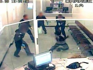 Perth, 2008: CCTV footage shows police repeatedly tasering Aboriginal man Kevin Spratt for refusing a strip search while incarcerated at the East Perth watch house. Spratt was humiliated, shackled and subjected to gruesome tasering. In just one week, police and prison guards tasered Spratt 41 times. Police and prison guards are responsible for the most hideous racist attacks on Aboriginal people. Over the last three decades, hundreds of Aboriginal people have been killed in custody at the hands of state forces.