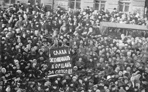 "Russia, International Women's Day, 1917: Mainly female textile workers go on strike for bread sparking a general strike and the toppling of the Tsar in the February Revolution. The banner reads ""Glory to the Women Fighters for Freedom!"""