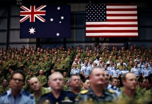 Australian and American troops in Darwin listen to the November 2011 speech by Obama where he outlined his agreement with the Australian government to station thousands of U.S. troops in Darwin in a move clearly aimed against socialistic China. NATO and its Australian ally have used the standoff over Ukraine to justify increased military deployments that are, in good part, aimed against China.