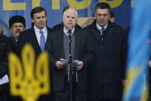 Kiev: Prominent US Senator John McCain openly supporting the Ukrainian right wing then opposition forces that took power in the February 2014 coup. Among the groups McCain lionised are outright fascist parties. Here pictured to McCain's left is the fascist Svoboda party leader, Oleh Tyahnybok.