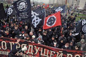 """Russian fascists, brandishing the """"White Power"""" symbol, hold a large march in Moscow. The capitalist counterrevolution that destroyed the USSR has led to the terrifying growth of fascist forces in Ukraine, Russia and other ex-Soviet republics."""
