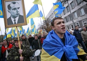 October2013: Supporters of the Ukrainian fascist Svoboda party with a portrait of Stepan Bandera. Bandera was the bloodthirsty leader of anti-Soviet, Nazi-collaborating Ukrainian fascists during World War II.
