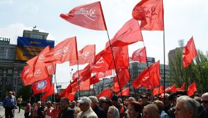 Communist Party of Ukraine (KPU) flags at a May Day 2014 rally in Ukraine. This party has faced vicious state repression and violent fascist attacks since the February 2014 right wing coup. The international workers movement must stand in solidarity with the KPU against right wing attacks.