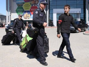 """Australian Federal Police arrive in Ukraine on the pretext of the MH17 air crash investigation. The deployment of these police - for work that should have been done by specialist pathologists and air crash investigators - to an area controlled by a force (the Donetsk rebels) that the Australian regime opposes was meant to assert Australian imperialism's """"right"""" to jackboot wherever they please. Australian cops are often deployed to enforce the Australian capitalists' tyranny over the peoples of the South Pacific."""