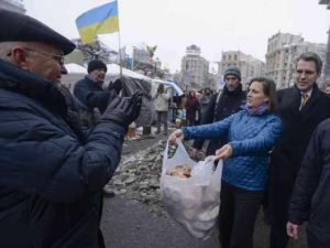Blatant! U.S. Assistant Secretary of State, Victoria Nuland, and U.S. Ambassador to Ukraine, Geoffrey Pyatt, hand out bread to the Ukrainian right wing, then opposition, forces in the lead up to their seizure of power in February 2014.