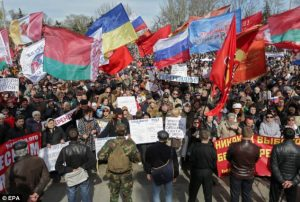 Donetsk, April 2014: Protesters fly the flag of Belarus alongside Russian and Ukrainian flags at this anti-governmentally. Alongside ethnic Russians, many people in the Donbass – including ethnic Ukrainians, Bulgarians and Byelorussians – use Russian as their main language. Thus, the Donbass rebel movement, based on Russian speakers, incorporates more than simply ethnic Russians alone.