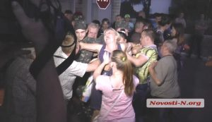 Mykolaiv, southern Ukraine, 2 September 2014: Relatives try to prevent conscripted Ukrainian soldiers from being sent to the eastern Ukraine front. The conscripted troops were only able to be taken away after police violently dragged away the protesting mothers and other relatives.