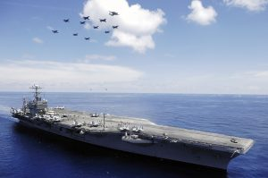 American aircraft carrier, the USS Abraham Lincoln, in the South China Sea. A very long way from home but not so far from China!