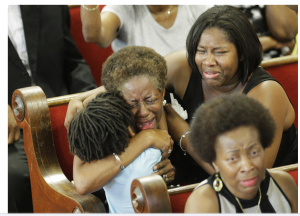 Charleston, South Carolina, United States: Friends and relatives of victims at a ceremony to mourn the murder of nine attendees at the Emanuel African Methodist Episcopal Church.