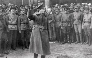From the time that they overturned capitalist rule in the 1917 Russian Revolution, the Soviet working class had to mobilise the forces of armed power to defend their liberation. In this picture, founder of the Soviet Red Army, Leon Trotsky, motivates troops in 1918 during the bloody Civil War against insurgent armies attempting to restore capitalist power.