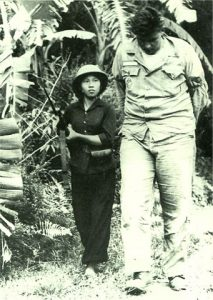 1966: A Vietnamese communist woman fighter marches a captured American airman through the jungle during the Vietnam war.