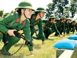 2014: Women soldiers in the army of the Vietnamese workers state in training. The founding personnel, traditions and culture of the Vietnamese workers state's organs were, like those of the other workers states in China, Cuba, North Korea and Laos, formed during the heroic liberation struggle against capitalism and imperialism. An important part of these new traditions and culture included placing women's role in society at a much higher level than where it had been during pre-revolutionary times.