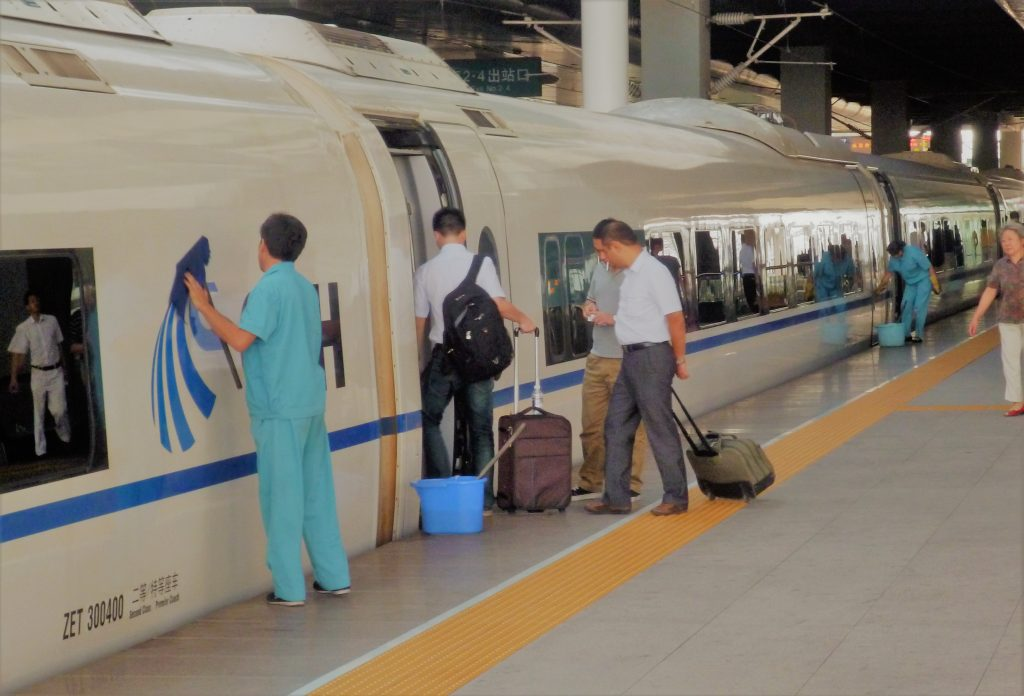 Workers clean a Chinese high-speed train prior to its 32 minute trip from Tianjin to Beijing. Like other state-owned enterprises (SOEs) in socialistic China, China Railways maintains a bloated workforce by capitalist standards in order to boost overall employment. This results in not only a high quality service for patrons but a relatively relaxed workplace environment for workers – especially when one considers the high level of job security for workers in most of China's SOEs. Such a low-stress workplace environment, where workers do not feel under pressure to cut corners on safety or recklessly speed up production, naturally leads to a relatively high level of workplace safety in China's socialistic SOEs. It is these SOEs that dominate the commanding heights of China's economy.