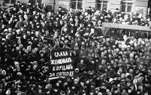 "Russia, International Women's Day, 1917: Mainly female textile workers go on strike for bread sparking a general strike and the toppling of the Tsar. The resulting revolutionary period that was opened up culminated half a year later in the October Socialist Revolution. The banner reads ""Glory to the Women Fighters for Freedom!"""
